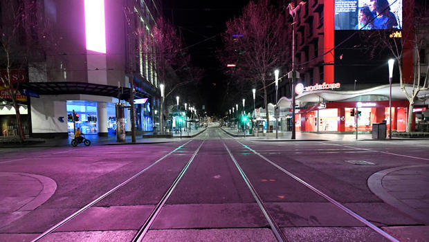An empty street is seen after a citywide curfew was introduced to slow the spread of COVID-19 in Melbourne