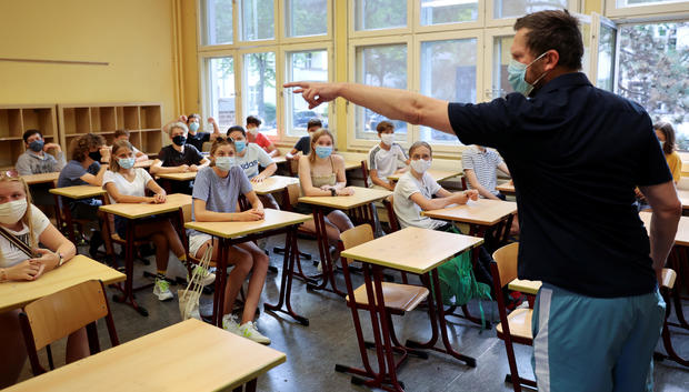 "Pupils of the protestant high school ""Zum Grauen Kloster"" attend a lesson on the first day after the summer holidays in Berlin"