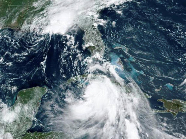 Tropical Storm Marco, top, arrives at the coast of Louisiana as Tropical Storm Laura follows in an image from the National Oceanic and Atmospheric Administration GOES-East satellite August 24, 2020.