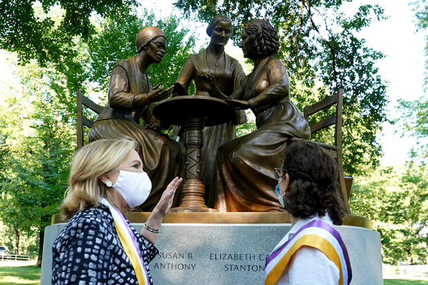 Former Secretary of State Clinton attends an unveiling of a bronze statue following the 100th anniversary of the ratification of the 19th amendment in Manhattan's Central Park
