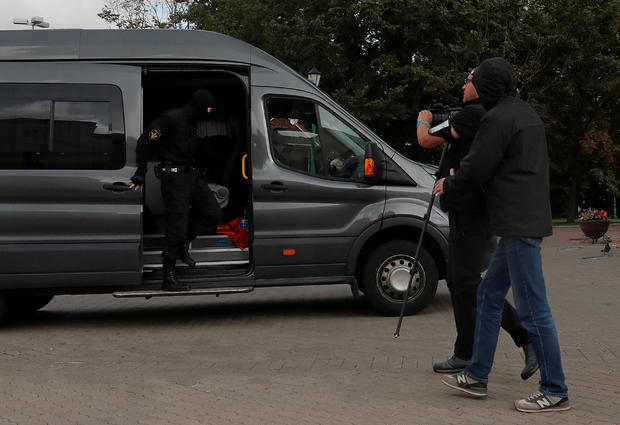Law enforcement officers detain a journalist in Minsk