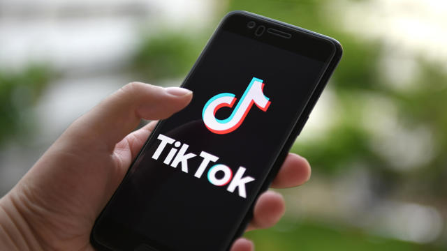 In this photo illustration a TikTok logo displayed on a
