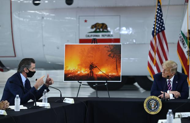 Biden and Trump responses to wildfires highlight divide on climate change