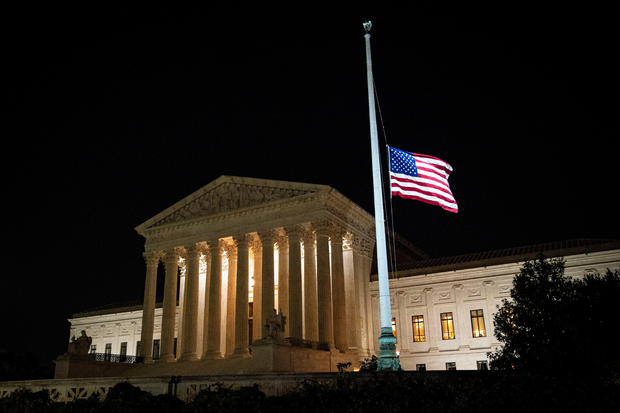 The American flag flies at half staff following the death of U.S. Supreme Court Justice Ruth Bader Ginsburg, outside of the U.S. Supreme Court, in Washington