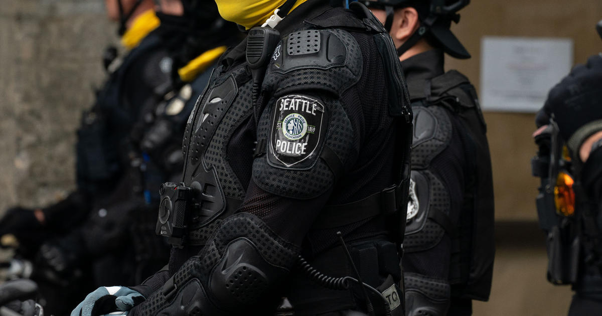 Cop on leave after allegedly walking bike over protester's head