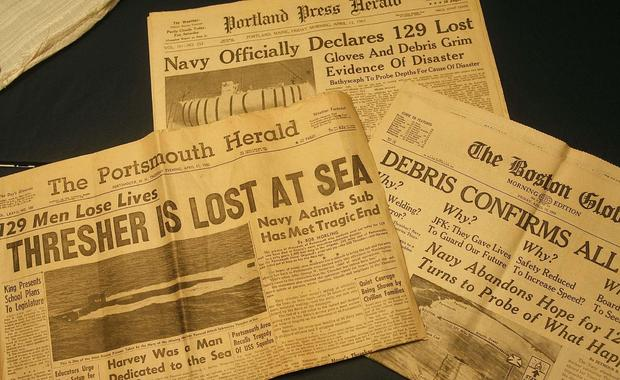 Yellowed newspapers from April of 1963 declare the tragedy of the USS Thresher. Photographed Tuesday