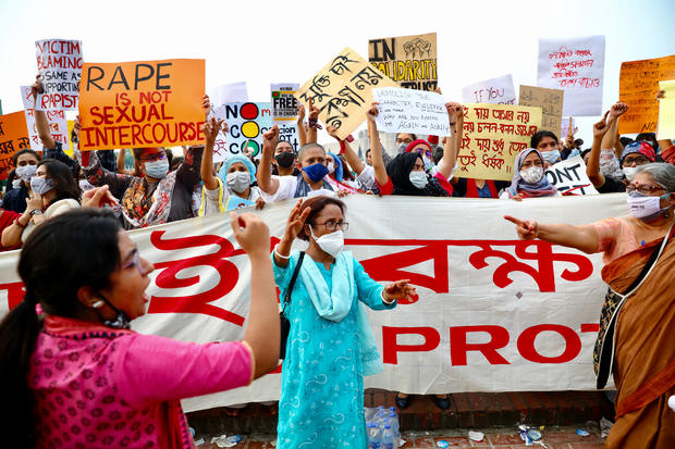 A feminist group take part in an ongoing protest demanding justice for the alleged gang rape of a woman