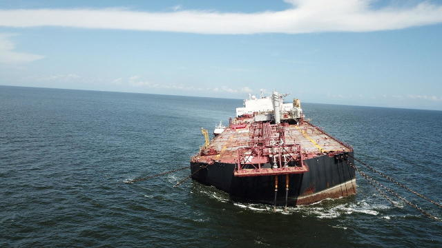 The Nabarima floating storage and offloading (FSO) facility is seen tilted in the Paria Gulf