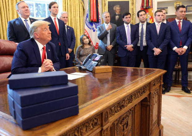 President Trump listens in the Oval Office on October 23, 2020, as Secretary of State Mike Pompeo, senior adviser Jared Kushner and national security adviser Robert O'Brien look on.
