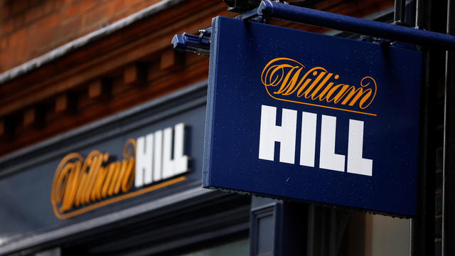 Signs are seen outside a branch of bookmaker William Hill in central London
