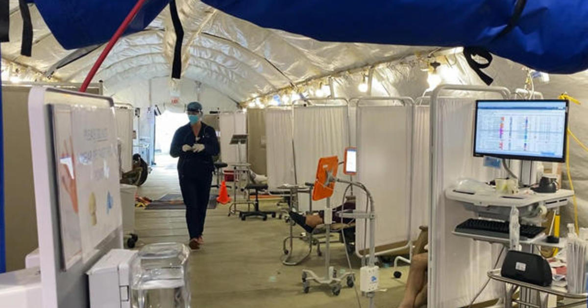 Hospitals overwhelmed as pandemic surges