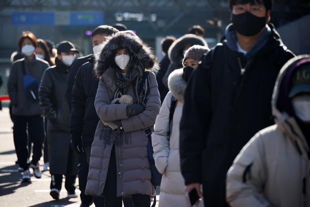 People wait in a line to undergo coronavirus disease (COVID-19) test at a coronavirus testing site in Seoul