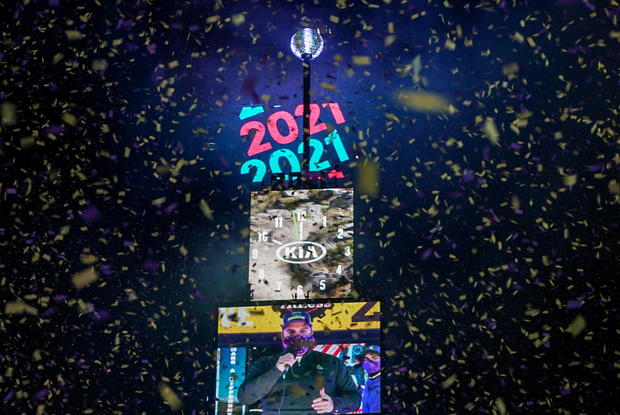 Confetti flies around the ball and countdown clock in Times Square during the virtual New Year's Eve event following the outbreak of the coronavirus disease (COVID-19) in the Manhattan borough of New York City