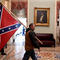 Trump supporter carries a Confederate flag in the U.S. Capitol