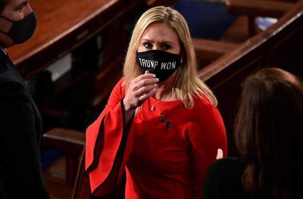 """U.S. Rep. Marjorie Taylor Greene (R-GA) wears a """"Trump Won"""" face mask as she arrives to take her oath of office as a member of the 117th Congress in Washington"""