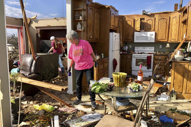 Patti Herring sobs as she sorts through the remains of her home in Fultondale, Alabama, on January 26, 2021, after it was destroyed by a tornado.