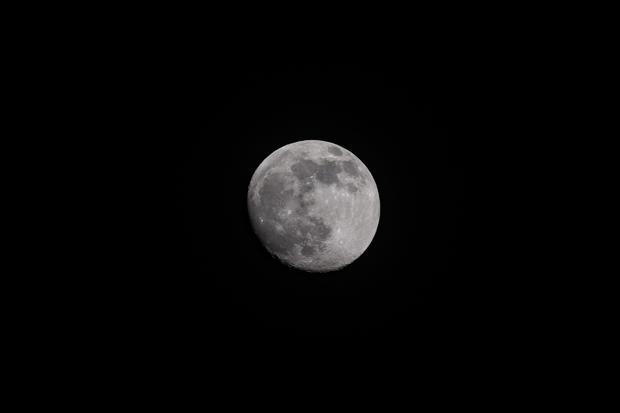 Waxing Moon In Cloudy Sky