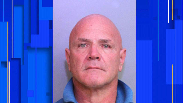 Polk County Fire Rescue Captain Anthony Damiano is seen in a police booking photo.