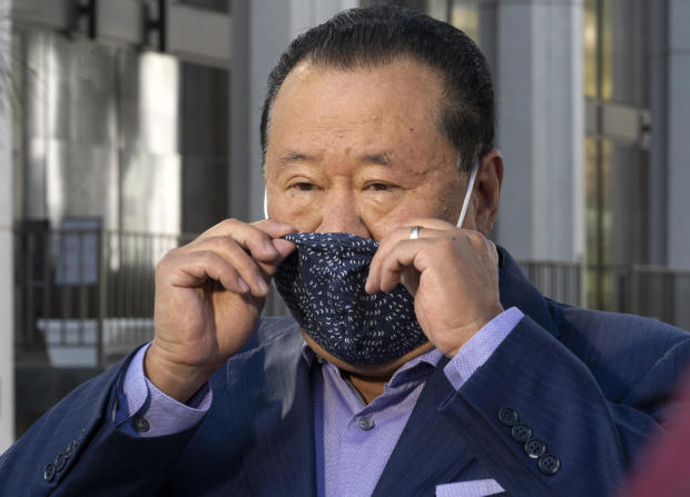 Che Ahn, Harvest Rock's senior pastor, adjusts his face mask before a news conference outside the Harvest Rock Church in Pasadena, California, February 7, 2021.