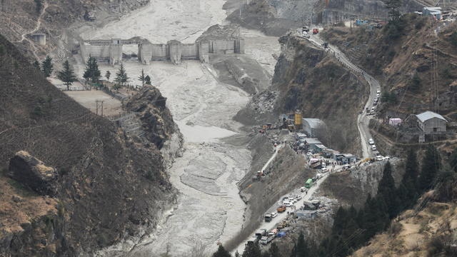 Rescue operation outside a tunnel after a part of a glacier broke away, in Tapovan