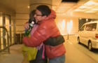 CBS News' Lucy Craft embraces her son Kohei as they're reunited four days after the March 11, 2011, earthquake and tsunami that devastated the northeast Japan region where Kohei was in high school.