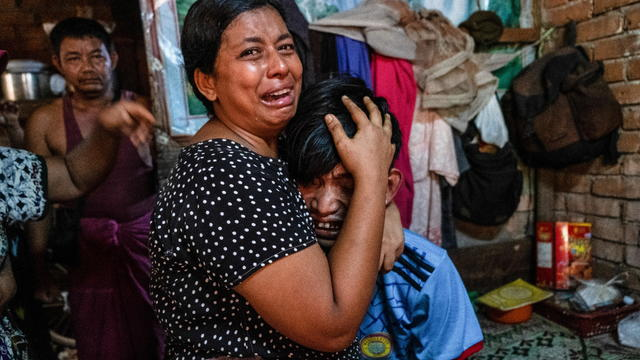 Family members mourn a man after he was shot dead during anti-coup protests, in Yangon