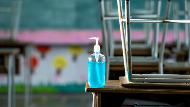 Disinfectant at elementary school student classroom desk.