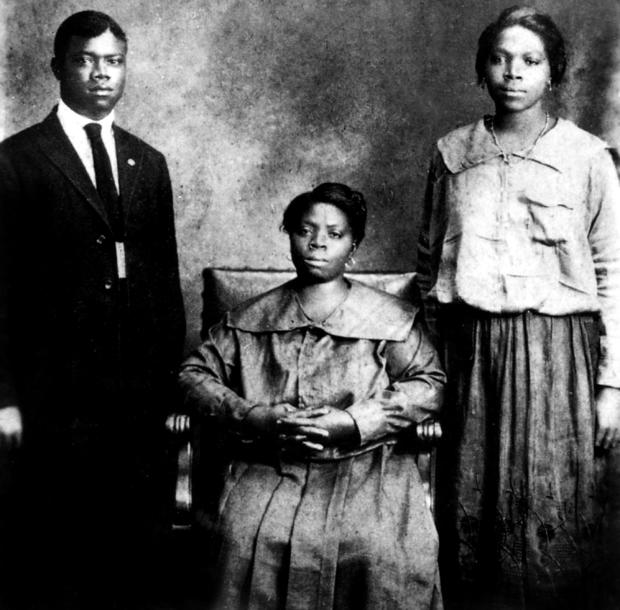 Louis Armstrong (1900-1971) american jazzman trumpet player and singer with mother and sister Beatrice in New Orleans in 1921