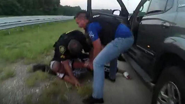 Stephanie Bottom is seen on the ground during a May 2019 traffic stop in North Carolina in an image capture from bodycam video.
