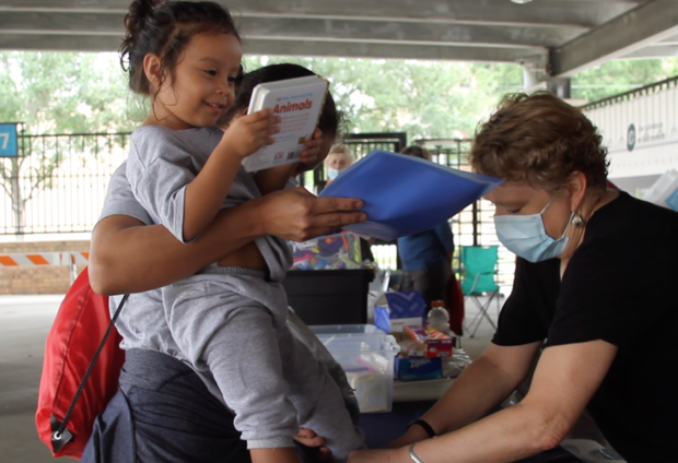 volunteers helping a child