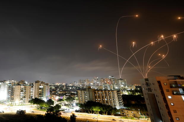 Streaks of light are seen as Israel's Iron Dome anti-missile system intercepts rockets launched from the Gaza Strip towards Israel, as seen from Ashkelon