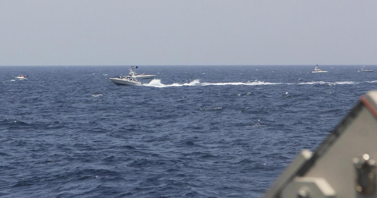 U.S. ship fires warning shots at Iranian boats
