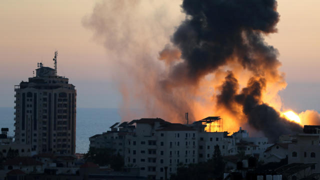 Smoke and flames rise during Israeli airstrikes as cross-border violence between the Israeli military and Palestinian militants continues in Gaza City May 14, 2021.