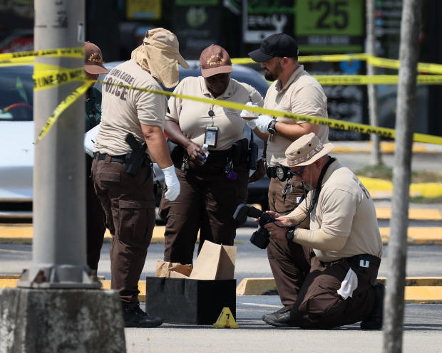 Miami-Dade police officers collect evidence after a mass shooting outside a banquet hall that had been rented out for a concert on May 30, 2021, in Hialeah, Florida.