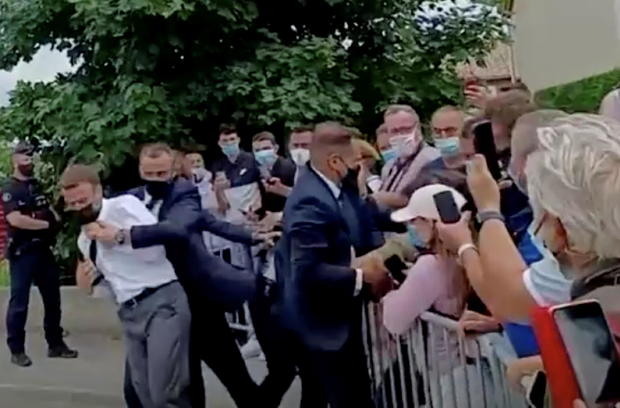 WATCH: French President Emmanuel Macron Slapped in the Face While Greeting People in Small Town