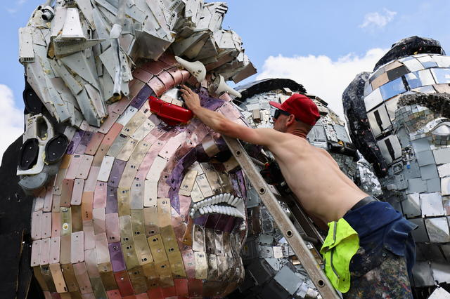 """Mount Recyclemore"""" sculpture to stare down Biden and other G7 leaders in U.K., demanding they tackle e-waste - CBS News"""
