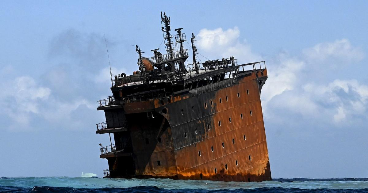 Burned, submerged cargo ship spills tons of plastic granules into sea and may be leaking oil