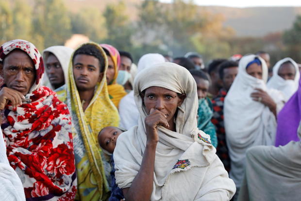 Women stand in line to receive food donations, at the Tsehaye primary school, in the town of Shire, Tigray region