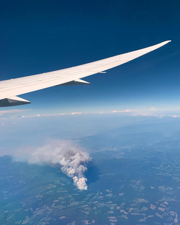 View shows a wildfire seen from an airplane, Lytton