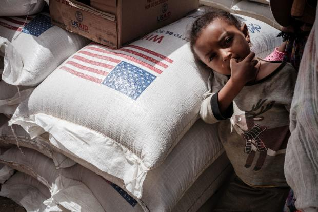 Child in Tigray waits to receive food aid