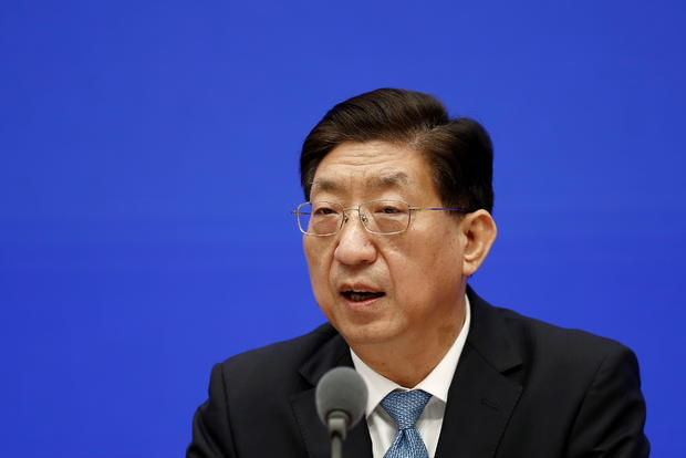 Zeng Yixin, vice minister of China's National Health Commission, attends a news conference in Beijing