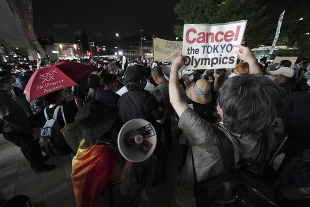 Anti-Olympic protestors demonstrating near the National Stadium in Tokyo