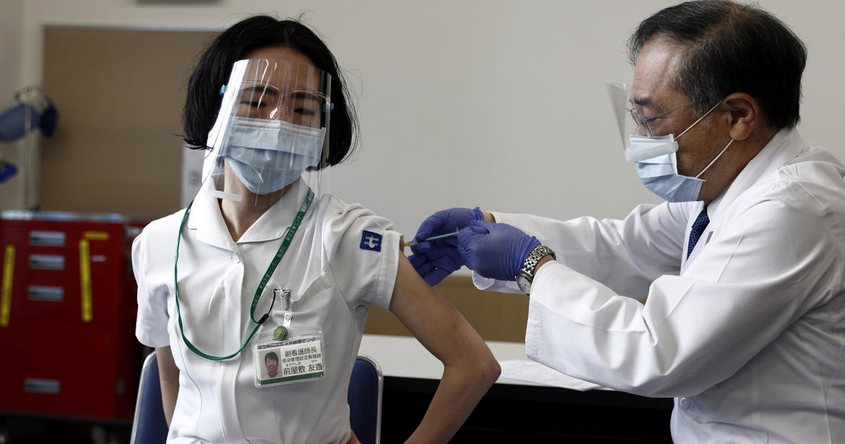 Olympic host Japan records record number of new COVID cases