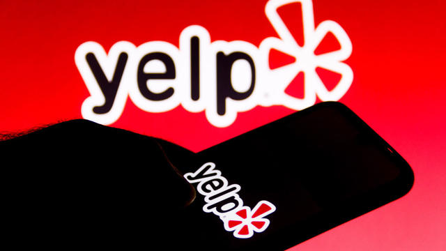 In this photo illustration a Yelp logo is seen on a
