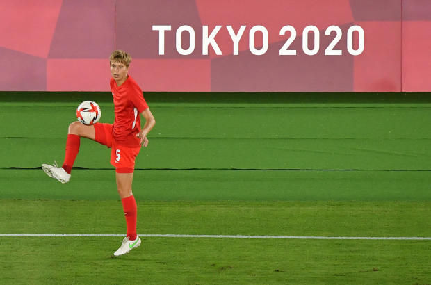 Canada's midfielder Quinn warms up prior to the Tokyo Olympic Games women's final soccer match between Sweden and Canada at the International Stadium Yokohama in Yokohama, Japan, on August 6, 2021.