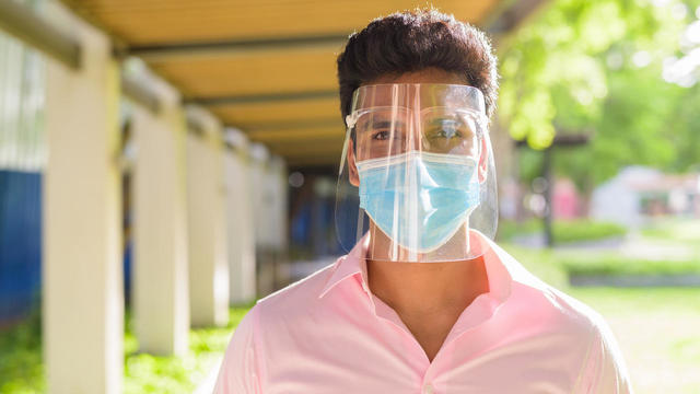 man wearing face shield
