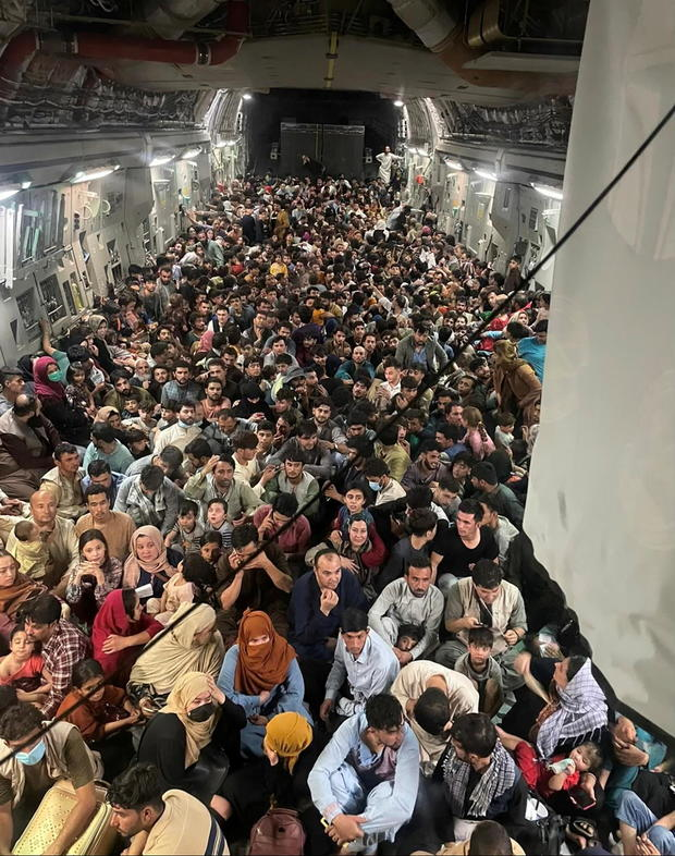 Evacuees crowd the interior of a U.S. Air Force C-17 Globemaster III transport aircraft departing Kabul