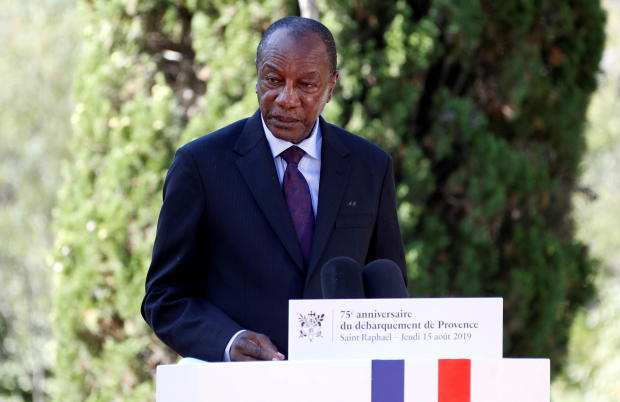 FILE PHOTO: Guinean President Alpha Conde delivers a speech