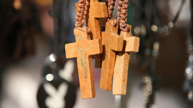 Close up of wooden crosses on rope necklaces