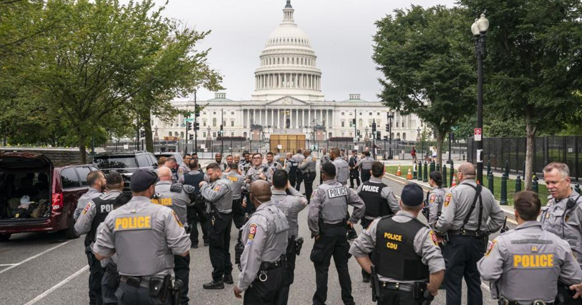 Heavy police presence as a few hundred protesters trickle in for rally at U.S. Capitol